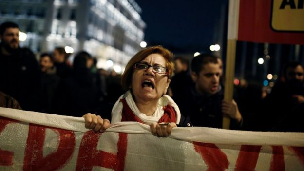 A protester shouts slogans during a rally against new reforms planned by the government in Athens, Greece on 15 January