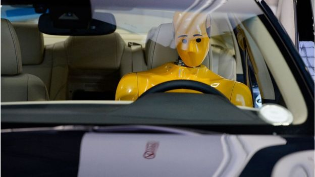 A crash test dummy at the Denver Auto Show