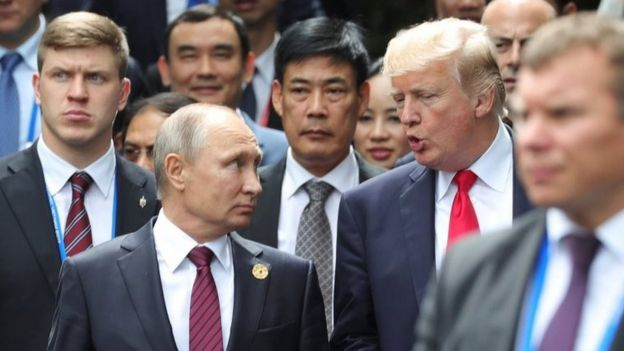 Russian President Vladimir Putin chats to Donald Trump at Apec summit on 11 November