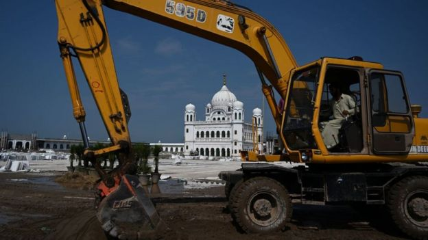 In this picture taken on September 16, 2019 a worker uses an excavator to level ground at the Sikh religious site Gurdwara Darbar Sahib, in the Pakistani town of Kartarpur near the Indian border.