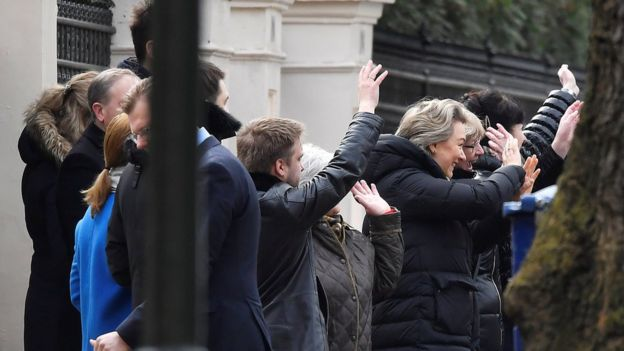 "Embassy staff wave as colleagues and children board buses outside Russia""s Embassy in London,"
