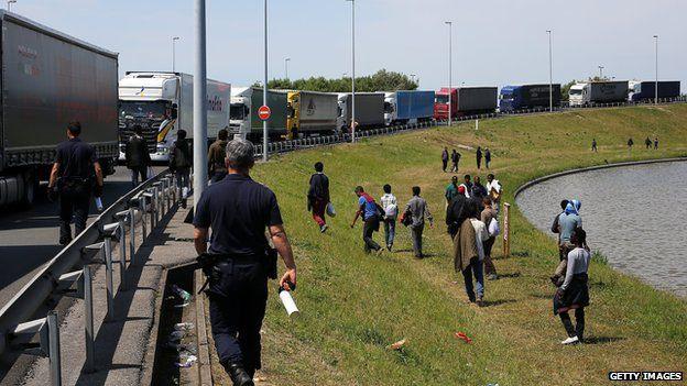 Migrants at motorway side