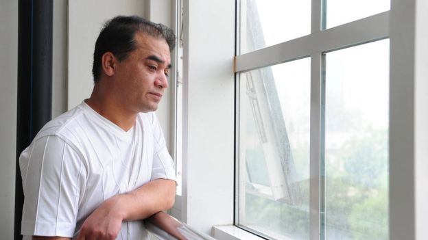 University professor, blogger, and member of the Muslim Uighur minority Ilham Tohti pauses for a few moments for a view from the window before a classroom lecture in Beijing on 12 June 2010.