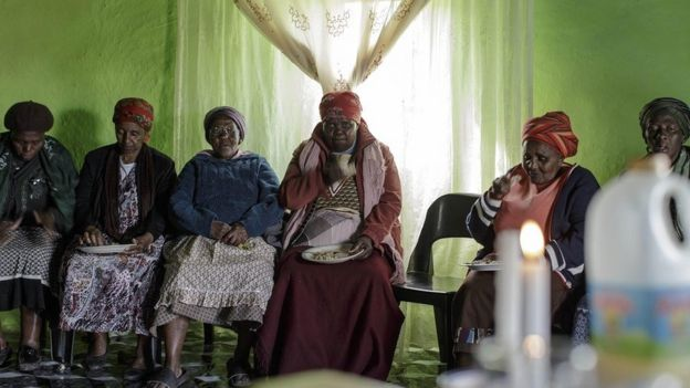 Women sitting for a funeral