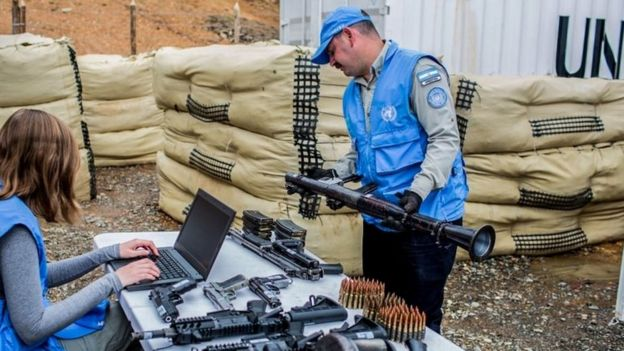 UN observers checking weapons handed by the FARC ,Cauca Department, Colombia on June 13, 2017.