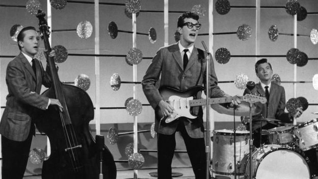 Joe Maulden, left, Buddy Holly, centre, and Jerry Allison on drums as The Crickets
