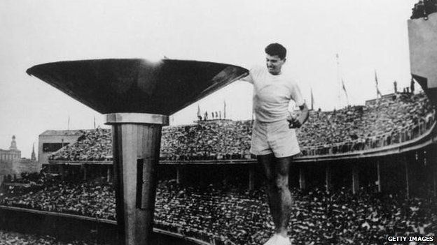 Ron Clarke of Australia lights the Olympic Torch at the opening ceremony of the 17th Olympic Games held in Melbourne during 1956