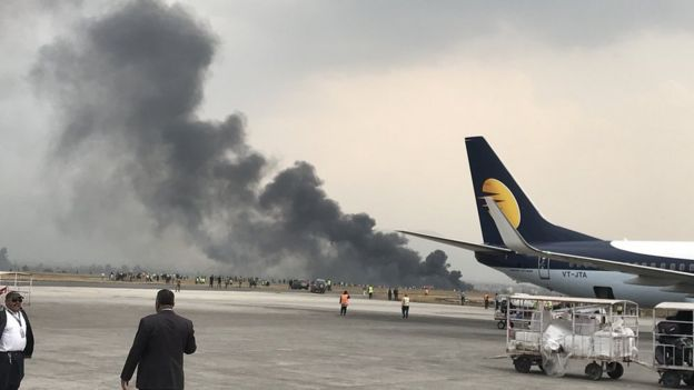 Photo showing smoke rising from the airport runway