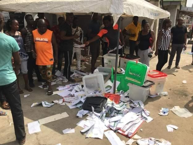 Destroyed ballot boxes in the Isolo district of the commercial capital, Lagos.