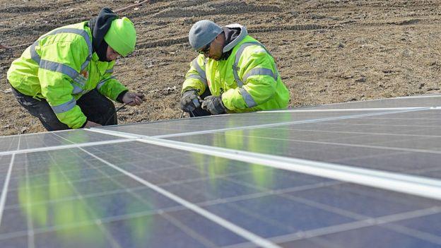 Technicians installing solar panels in Ohio