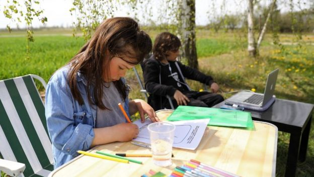 Children studying in Ciszyca Dolna, southeastern Poland, 24 Apr 20