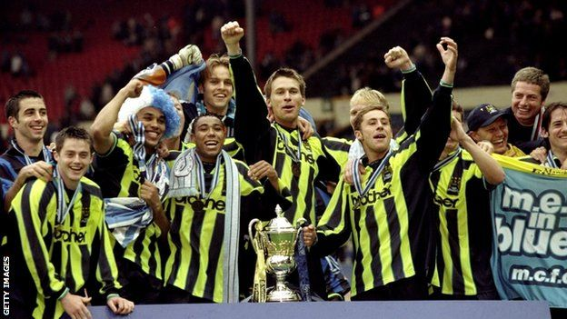 Manchester City football players celebrate achieving promotion in 1999