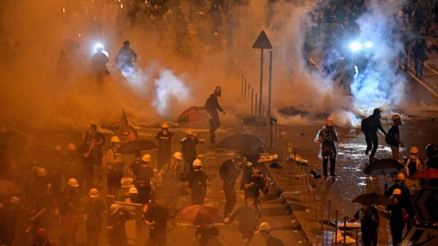 Police fire tear gas at protesters near the government headquarters in Hong Kong