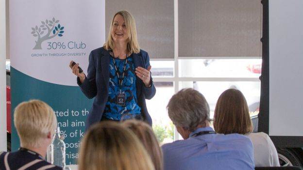 Julianne Miles speaking at an event