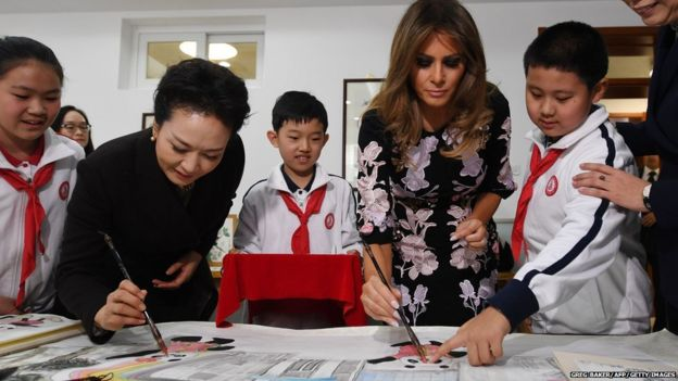 First Lady Peng Liyuan and First Lady Melania Trump paint a panda with school children