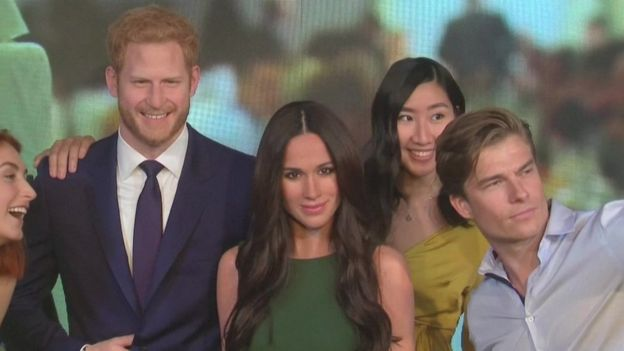 Visitors take selfies with wax figures of Harry and Meghan in Madame Tussauds London