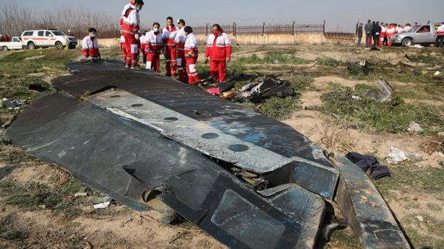 Search and rescue teams comb the wreckage of a Boeing 737 that crashed near Imam Khomeini Airport in Iran just after takeoff on January 08, 2020