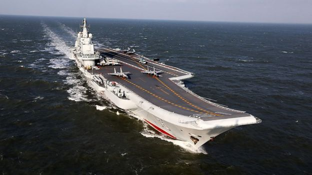 This photo taken on 24 December 2016 shows the Liaoning, China's only aircraft carrier, sailing during military drills in the Pacific.