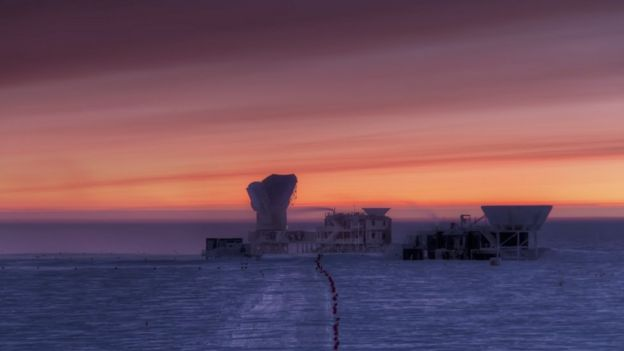 Sunset behind a telescope on the Antarctic ice