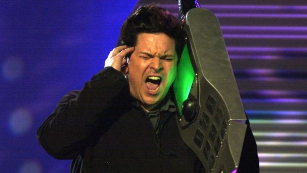 Dom Joly with a huge mobile phone