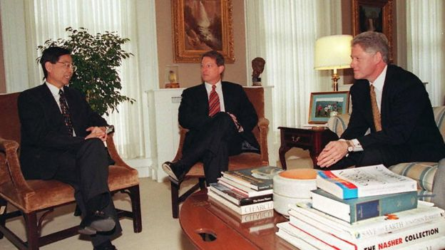 US President Bill Clinton (R) and Vice President Al Gore (C) listen to Martin Lee (L) leader of Hong Kong's Democratic Party during meetings in the Old Executive Office Building in Washington 18 April 1997. Lee is in Washington seeking US support on Hong Kong issues before it reverts to the control of the Peolple's Republic of China 01 July.