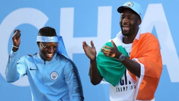 "Manchester City""s Benjamin Mendy (left) and Yaya Toure"