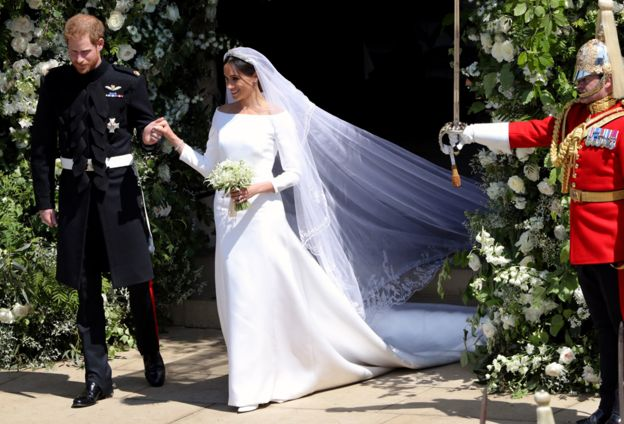 d0a380bfdbb2 Prince Harry and Meghan Markle leave St George s Chapel in Windsor Castle  after their wedding.
