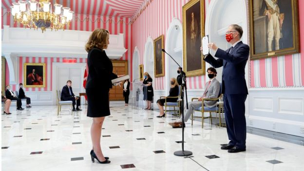 Chrystia Freeland is sworn-in as finance minister at Rideau Hall as Justin Trudeau looks on