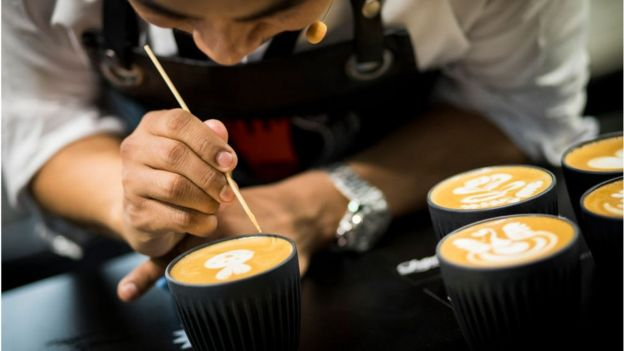 UK Latte Art Champion Dhan Tamang demonstrates latte art during the London Coffee Festival 2019