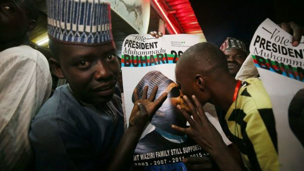 Supporters of Nigeria's President Muhammadu Buhari celebrate in Kano, Nigeria, after he won a second term February 26, 2019