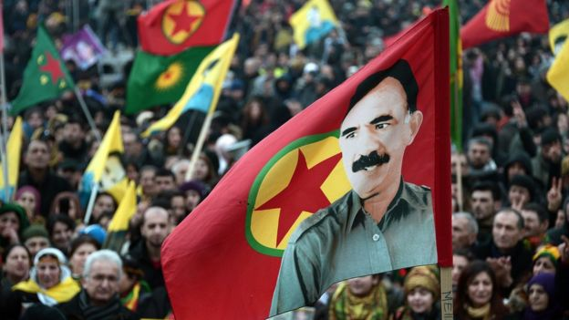 Members of the Kurdish community wave flags and banners showing the face of jailed Kurdistan Worker's Party (PKK) leader Abdullah Ocalan, during a demonstration calling for his release in Strasbourg, France, on 14 February 2015