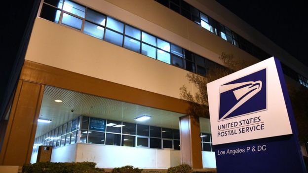 Photo shows the entrance to the United States Postal Service (USPS) Processing and Distribution Center in Los Angeles