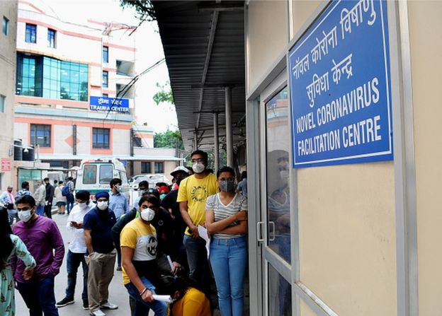 Indian People queue up at a COVID screening center at Ram Manohar Lohia Hospital,(RML) after a case emerged in Delhi causing a panic situation in Delhi India, 04 March 2020.