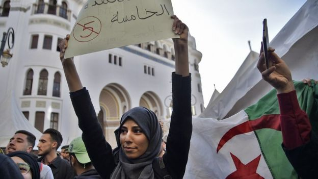 A young Algerian woman demonstrating in the capital Algiers on 5 March, 2019