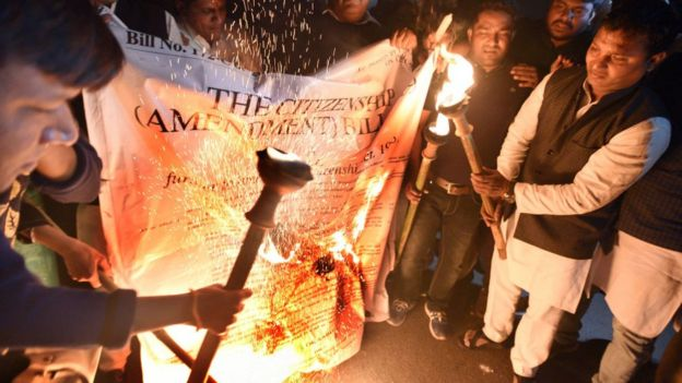 NYC National President Srinivas B.V with party supporters during a torch procession against the Citizenship Amendment Bill at Rajpath near India Gate, on December 11, 2019 in New Delhi, India. Normal life came to a halt on Tuesday in several states amid protests over the Citizenship (Amendment) Bill.