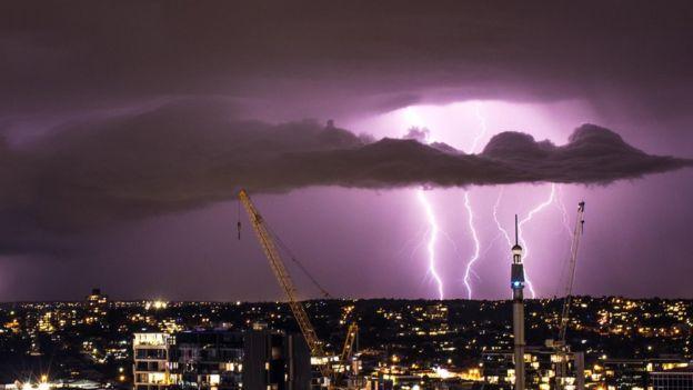 Image copyright Alex Gregg Night sky with lightning & Lightning storm blazes across Queensland skies - BBC News azcodes.com