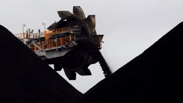 A machine places coal in stockpiles at a coal port in Newcastle, Australia