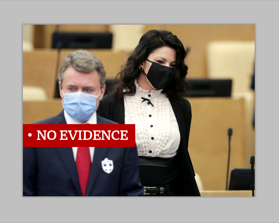 "Two people with face masks, one sporting a badge with a cross on it. Labeled ""no evidence""."