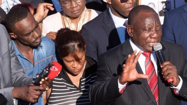 President Ramaphosa talking to people