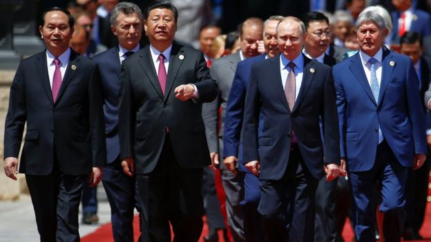 Chinese President Xi Jinping and other leaders arrive for a family photo during the Belt and Road Forum at meeting