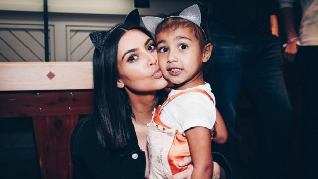 Kim Kardashian and daughter, North West posing at Ariana Grande event in 2017 in matching cat ears