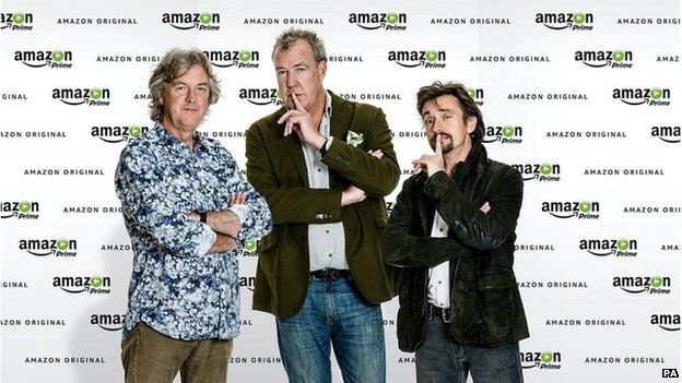 James May, Jeremy Clarkson and Richard Hammond in front of Amazon Prime backdrop