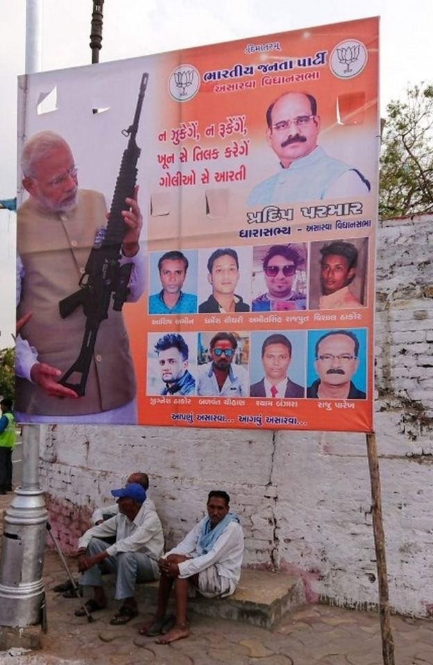 A billboard displaying an image of Indian Prime Minister Narendra Modi holding a rifle is seen on a roadside in Ahmedabad on March 3, 2019.