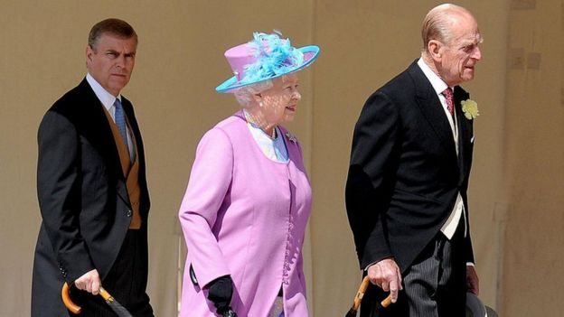 Queen Elizabeth II accompanied by her son Prince Andrew and husband Prince Philip, on her way to a garden party in the grounds of Buckingham Palace