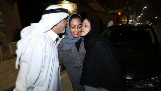 Hannan Iskandar is kissed by her parents, after she drove her car in her neighborhood, in Al Khobar, Saudi Arabia,