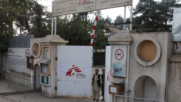 Afghan guards stand at the gate of the MSF hospital after an air strike in the city of Kunduz, Afghanistan (October 3, 2015)