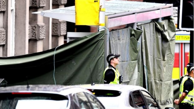 a bus shelter has been covered by police at the scene