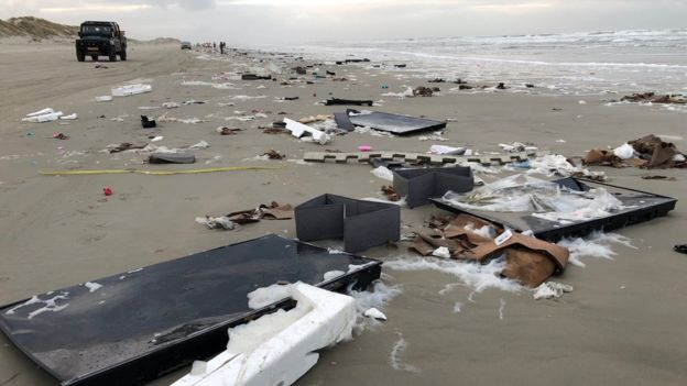 Broken TVs lay on the beach on Terschelling hours after the containers fell into the sea