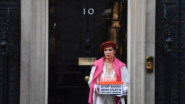 Human rights advocate Bianca Jagger delivers a petition urging the UK government to halt arms sales to Saudi Arabia and to free jailed Saudi blogger Raif Badawi at 10 Downing Street in London on March 15, 2017