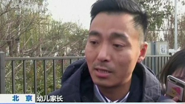 Picture of parent being interviewed in CCTV report on the RYB Education case